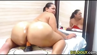 naughty latina with big ass rides dildo on webcam