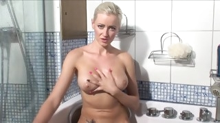 sexy blonde takes a bath